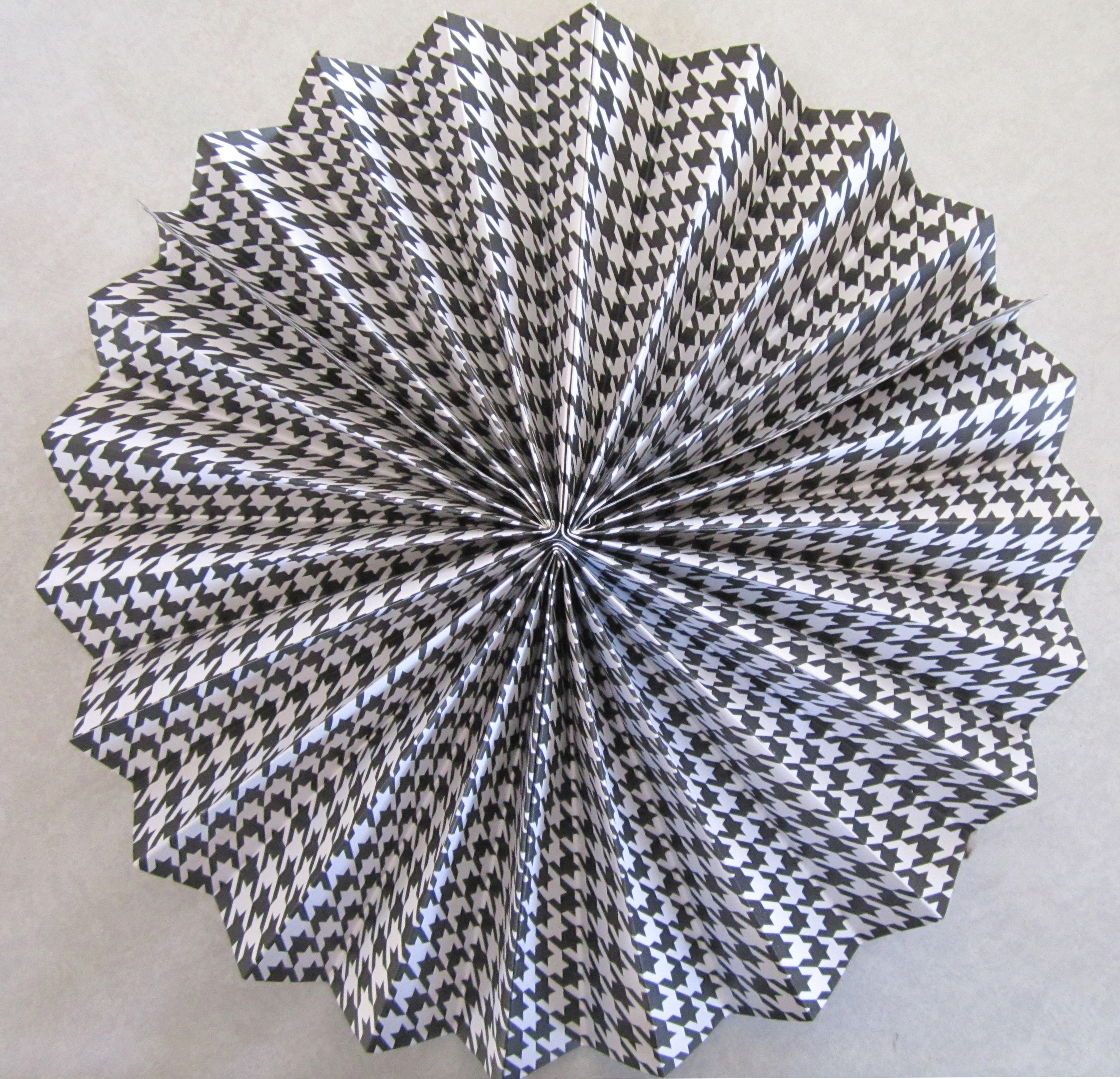 How to make rosettes out of paper - Love The Variety Of Fan Sizes And Color Of Patterns