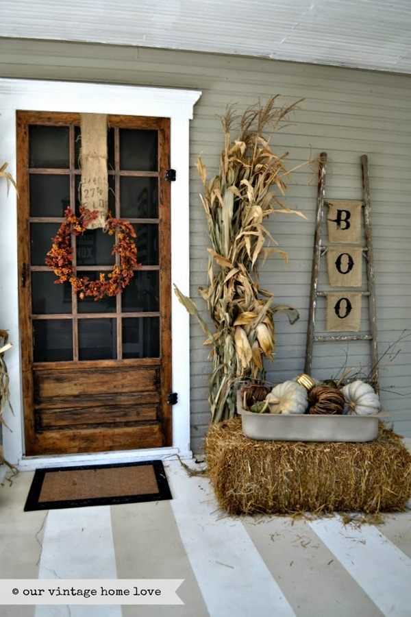 10 Fall Front Porch Decorating Ideas by A Blissful Nest - This front porch fall decor is so simple but still gives the perfect amount of rustic, fall feel without feeling overwhelming.