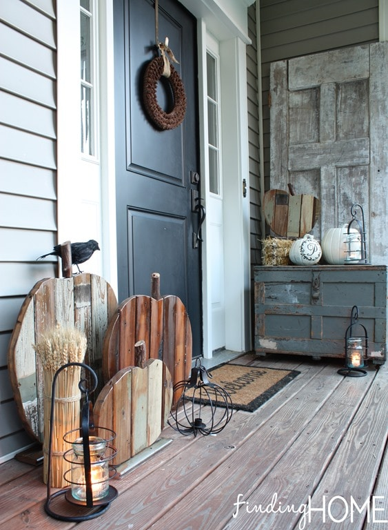 10 Fall Front Porch Decorating Ideas by A Blissful Nest - This front porch fall decor uses rustic wooden textures and neutral colors to make a bold fall statement.