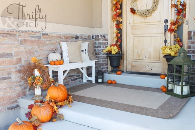 10 Fall Front Porch Ideas by A Blissful Nest - This front porch fall decor uses rich colors and cute little pumpkins to make a bold fall statement! The fresh flower arrangements complete the look.