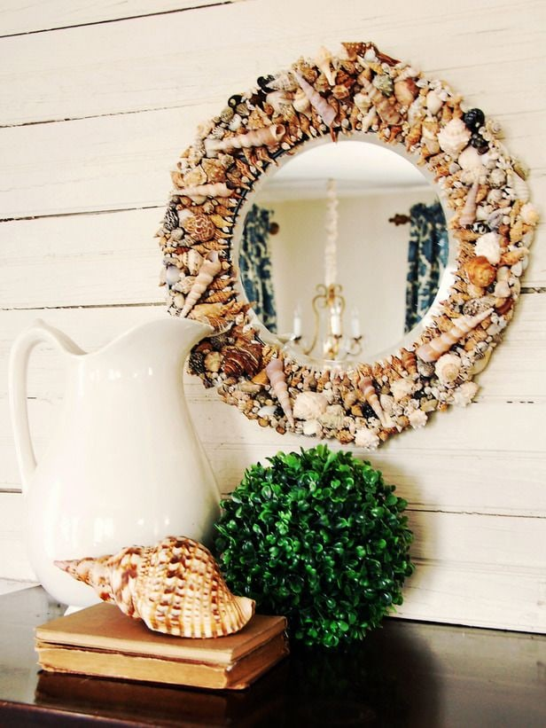 Decorate with a shell mirror for a coastal look