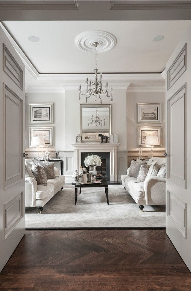 How to decorate with neutral colors: another all-white living room sparkles with silver and black accents, giving this room a clean, yet elegant and comfortable feel.