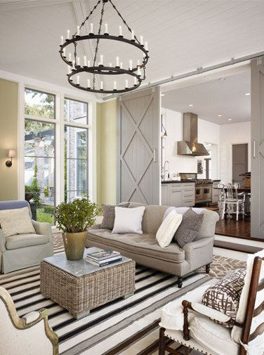 How to decorate with neutral colors: this living room is full of neutral browns, greys, and yellows - but with the addition of stripes, textures, and patterns, there is NOTHING boring here!