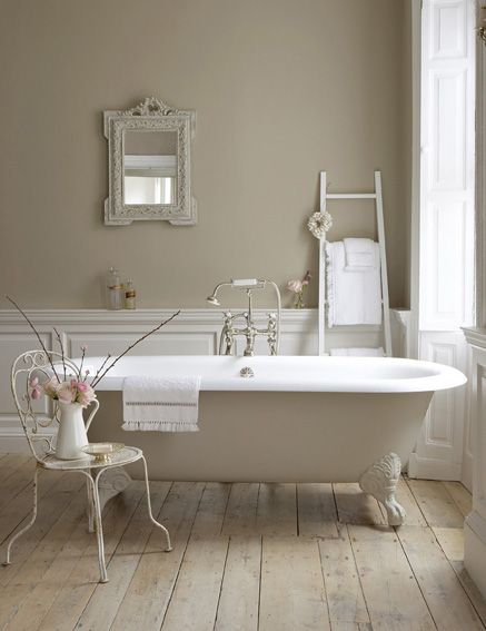 How to decorate with neutral colors: painting the whole room a neutral color with major statement pieces of white liven up this bathroom while making it the perfect place to relax and unwind!