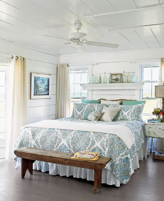 Hang a floating shelf above a bed for visual interest and a dramatic effect. More ideas for decorating above a bed on A Blissful Nest. https://ablissfulnest.com