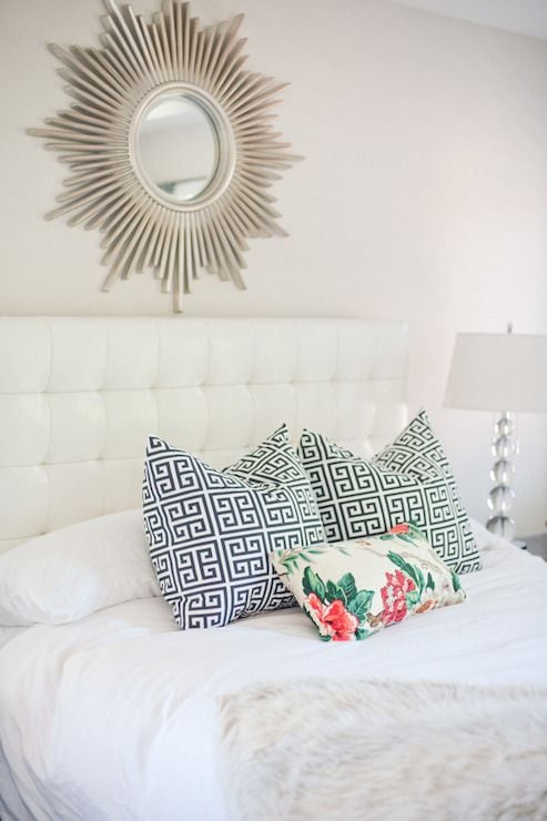 Add a sunburst mirror above the bed