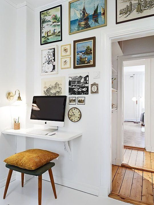 Use a floating shelf to save space for a small home office