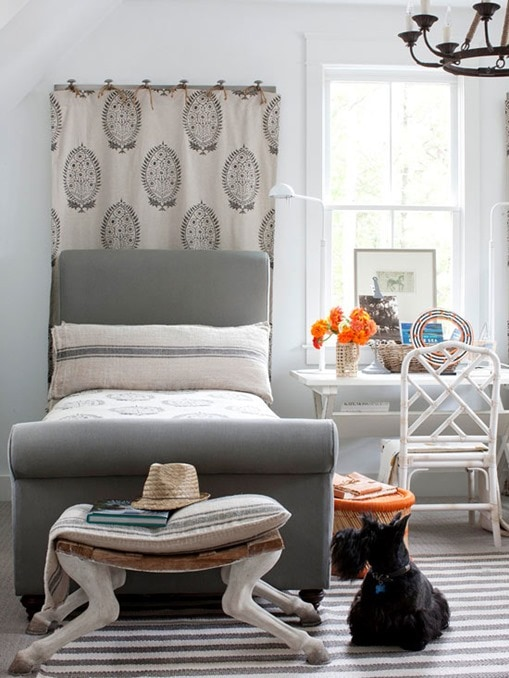 patterened-fabric-behind-headboard-bhg
