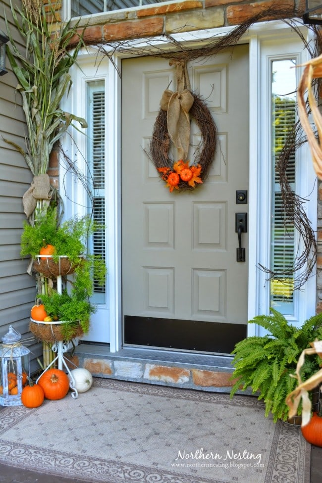 This is packed with fall colors and still looks inviting. #fallporch #falldecor #falldecorating