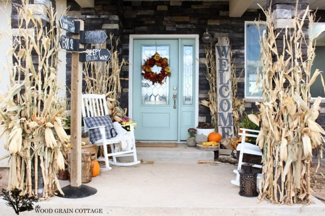 Fall Front Porch Woodgrain Cottage - Fall front porch ideas reminiscent of a cozy cabin in the woods.