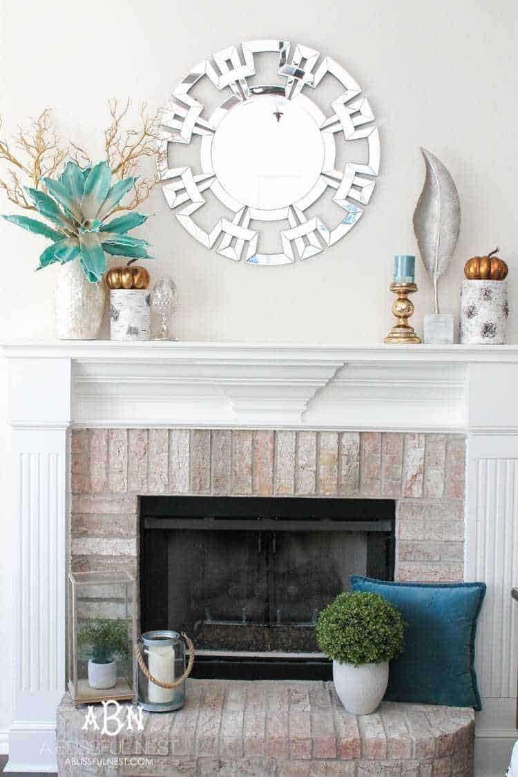 Love the turquoise pops in this fall mantel idea. #ABlissfulNest #fallmantel #falldecor