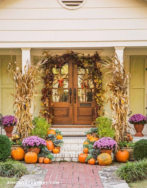 Love the beautiful pop of purple mixed in with the fall colors. #fallporch #fallfrontporch #fallideas