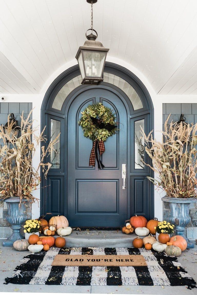 Cornstalks and pumpkins make this a beautiful fall porch to enjoy!