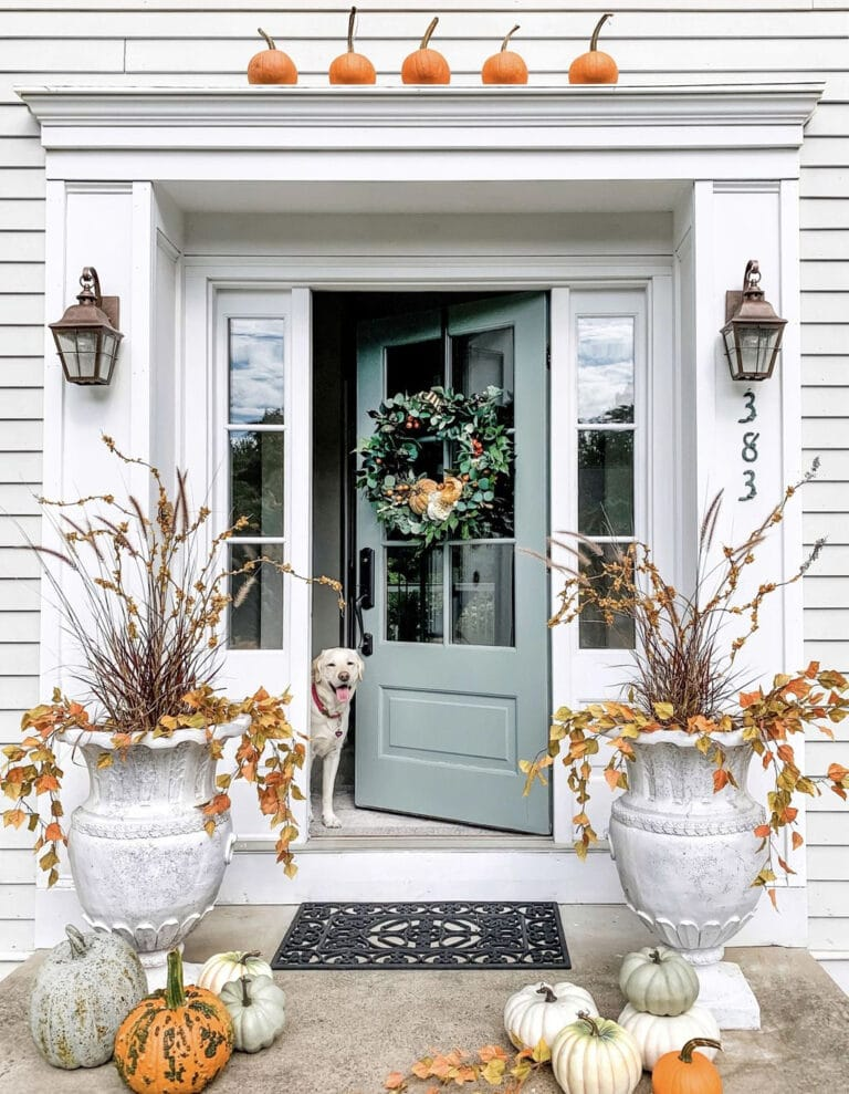 Oversized urns, turquoise door, classic front porch decor.
