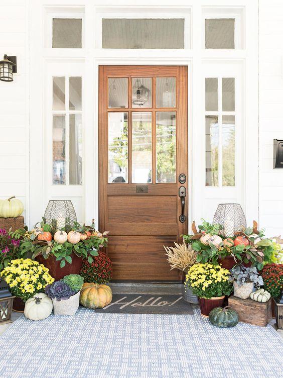 Cluster of pumpkins, galvanized bins, simple autumn fall porch.