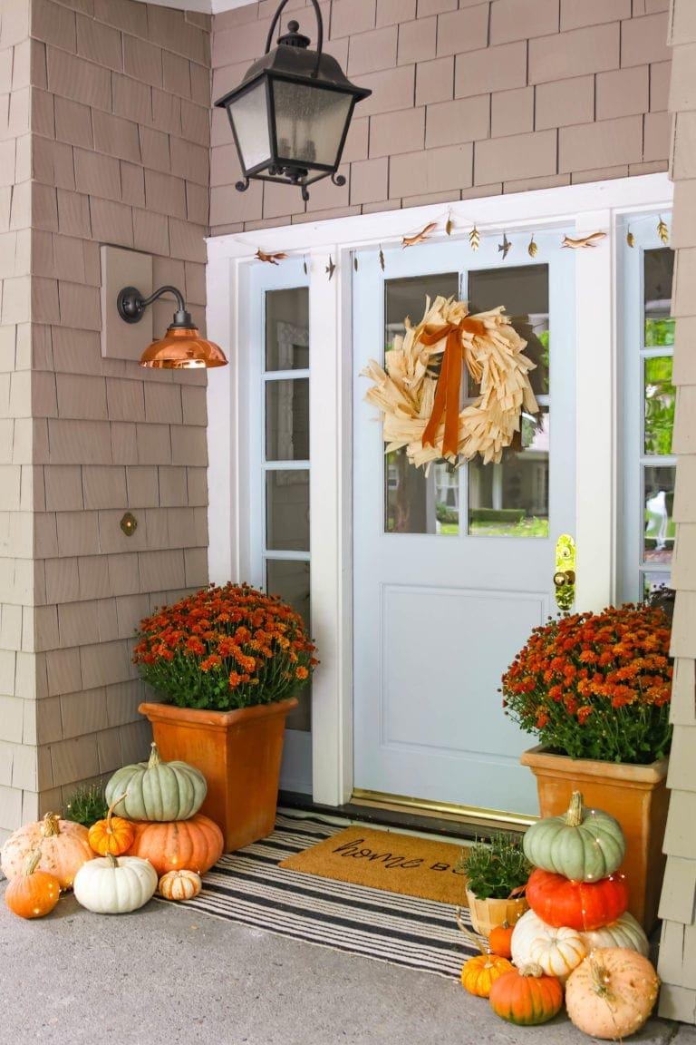Corn husk wreath, heirloom pumpkins, fall porch.