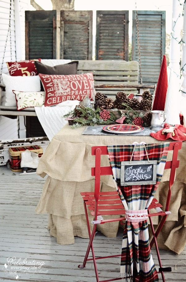 Celebrating Everyday Life Christmas Porch porch swing, Christmas Pillows, Plaid blanket, Pine Cones - christmas porch ideas