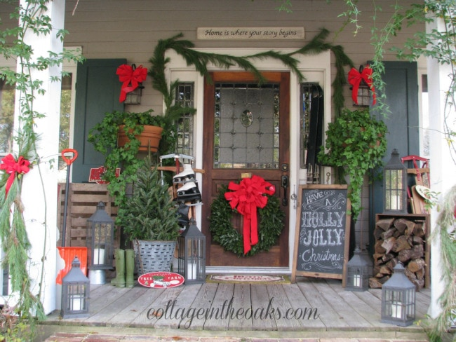 Cottage in the Oaks Christmas Porch, Chalkboard Art, Ice Skates, Sled, Fresh Garland - Christmas porch ideas from A Blissful Nest