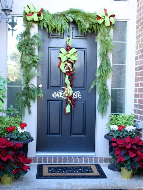 Decorchick Christmas Porch, Poinsettias, Fresh Garland, Bow Wreath - Christmas porch ideas from A Blissful Nest