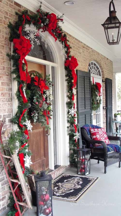 Our Southern Home Christmas Porch, Snowflakes, Garland, Red Bows, Ornaments in Lanterns