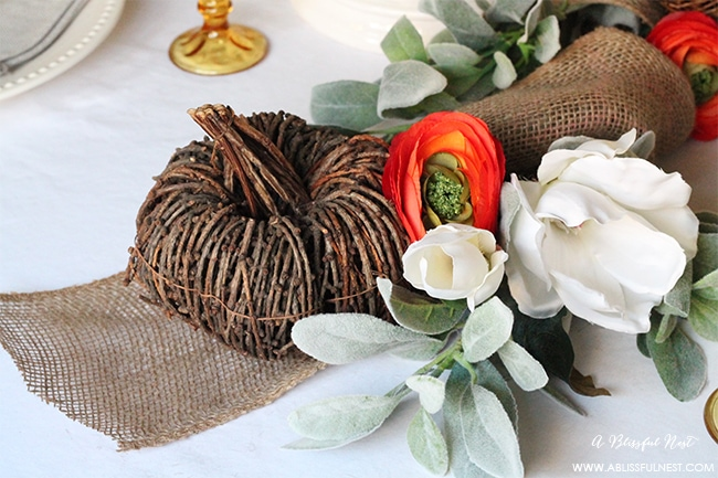 use beautiful faux flowers wrapped with burlap and grapevine pumpkins for the center of your table.