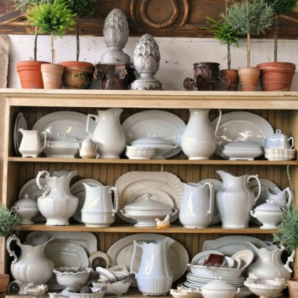 Decorate with white ironstone pitchers with topiaries and other garden accents.