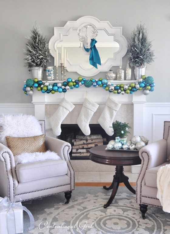 Christmas mantels - bright blue and green ornament garland and white stockings - Christmas Mantel Centsational Girl