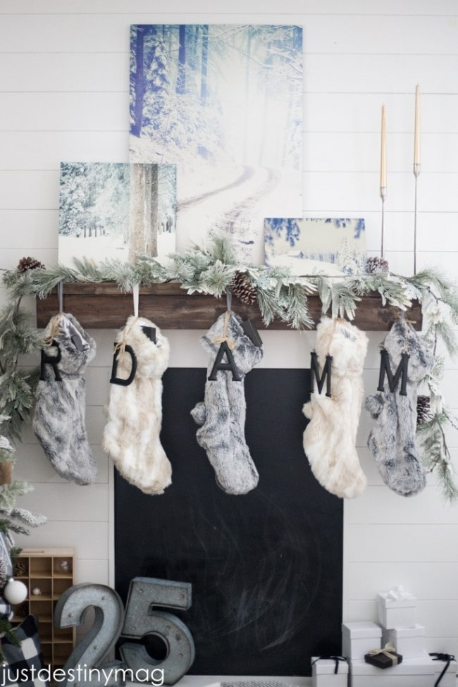 Christmas mantels - winter wonderland mantel with winter paintings and white, grey and silver accents - Christmas Mantel Just Destiny