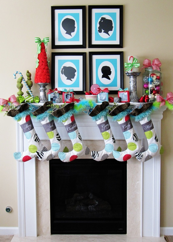 Christmas mantels - colorful mantel with blue, white, and red stockings, red christmas tree, colorful ornaments - Christmas Mantel Positively Splendid