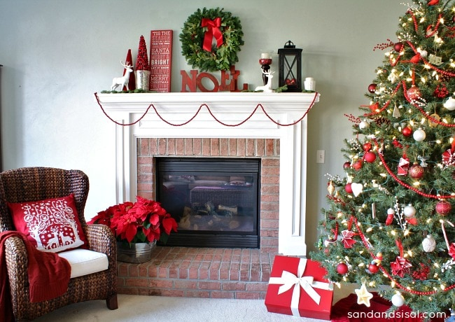 Christmas mantels - classic christmas mantel with christmas tree, ornaments, and holly berry wreaths - Christmas Mantel Sand and Sisal
