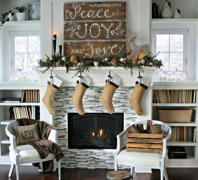 Christmas mantels - rustic burlap stockings, wooden christmas sign and white tile fireplace - Christmas Mantel The LIly Pad Cottage