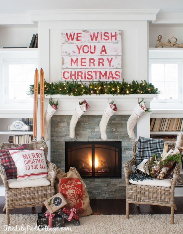 Christmas mantels - simple christmas mantel with gold garland and antique skis - Christmas Mantel The LIlyPad Cottage