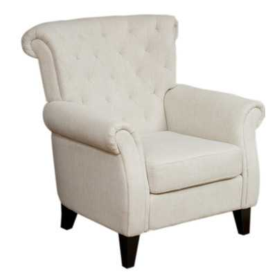 Adore the tufting on this accent chair! 25 of the best affordable accent chairs on ablissfulnest.com
