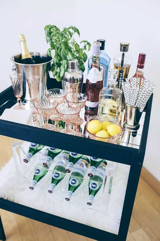 Use our recipe for success to stock the PERFECT bar cart! A complete list of all the essential items you need for the most stylish bar cart for your next party by A Blissful Nest.