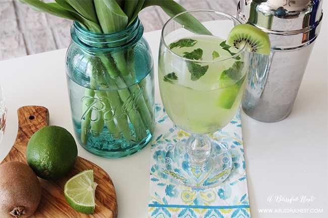 This delicious and refreshing cocktail recipe is perfect for your next gathering with friends. Entertain with this Vodka Kiwi Sour Cocktail Recipe for a unique twist for your dinner party. Recipe details on ablissfulnest.com
