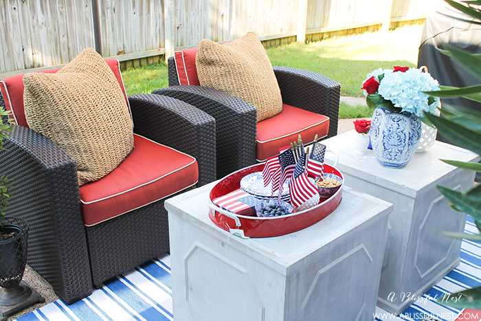These are such great ideas to celebrate 4th of July with! I love all the Americana red, white and blue pops of color on this patio. Check out more on A Blissful Nest. http://ablissfulnest.com #4thofjuly #4thofjulydecor #redwhiteandblue