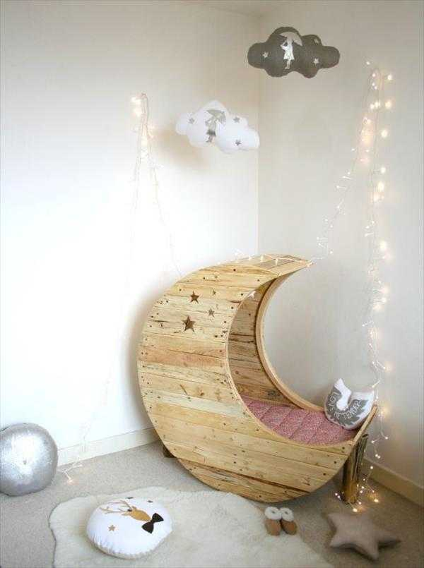 DIY Pallet Moon Shaped Baby Cradle, 20 Amazing Pallet Projects via A Blissful Nest