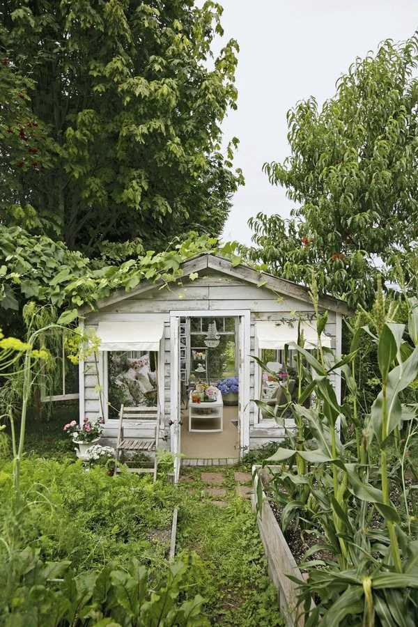 Shabby Chic She Shed via House Beautiful, The Best She Sheds via A Blissful Nest