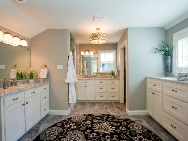 This spacious bathroom is light and bright with natural light and stunning blue gray walls. HGTV Bathroom Flips, 20 Best Fixer Upper Rooms