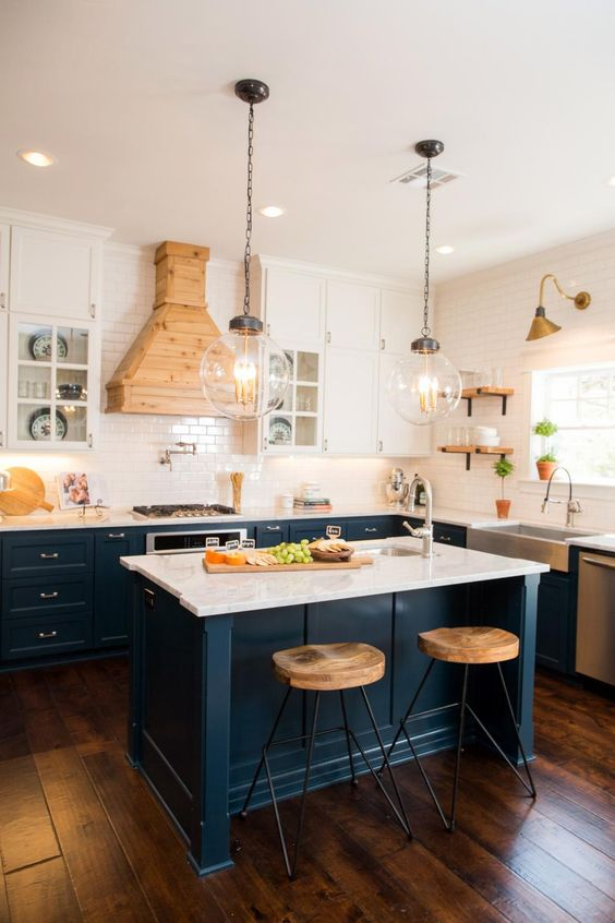 These navy blue kitchen cabinets are the perfect pop of color in this kitchen. HGTV Craftsman Fixer Upper for 2 Fearless Newlyweds, 20 Best Fixer Upper Rooms