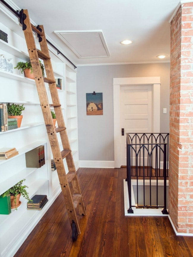 This upstairs landing does not go to waste in this home. Love this library bookcase concept, and the ladder adds a little bit of farmhouse flair without overtaking the scene. HGTV Texas Sized House, 20 Best Fixer Upper Rooms