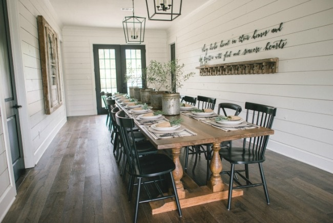You can fit SO many people in this dining room! Love this farmhouse inspired buffet dining table. Magnolia Market The Barndominium, 20 Best Fixer Upper Rooms