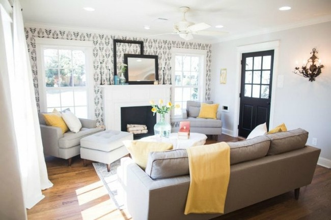 This cozy living room makes a statement with bold wallpaper and stunning black, yellow, and neutral colored accents. Magnolia Market The Chicken House, 20 Best Fixer Upper Rooms