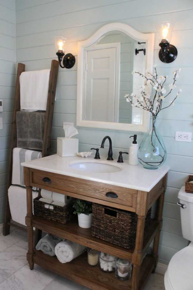 bathroom with shiplap walls and an up cycled piece of furniture for the vanity - Fixer Upper Bathroom