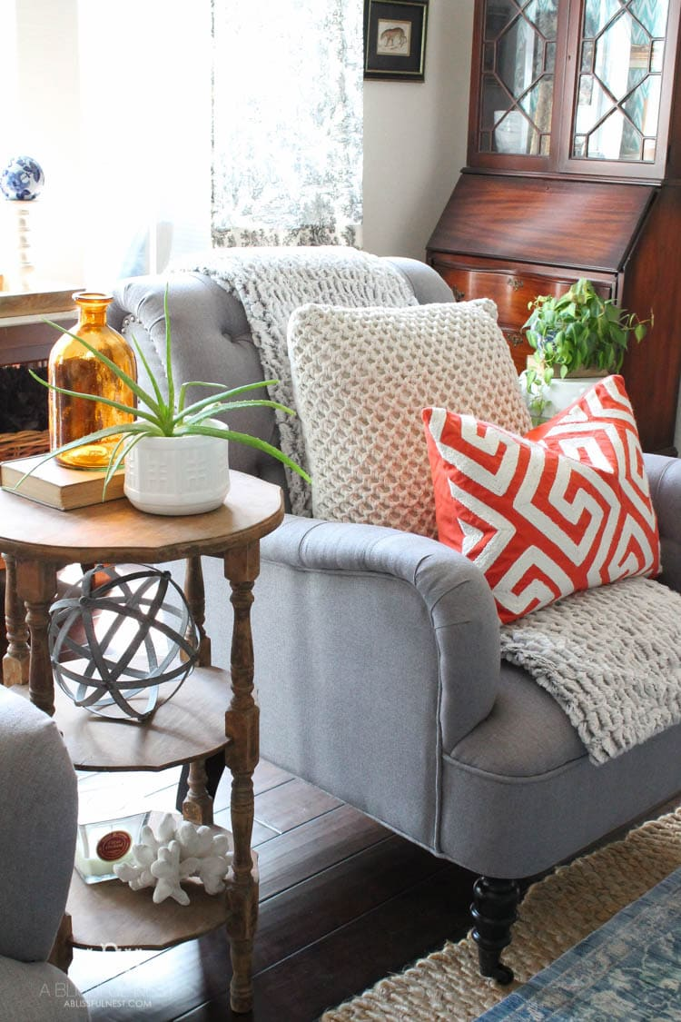 Check out these gorgeous coastal accents in this fall home tour with A Blissful Nest! Love the pops of orange in this home with its neutral pallet. See more at http://ablissfulnest.com/ #fallfrontporch #falldecorating #falldecor #fallhometour
