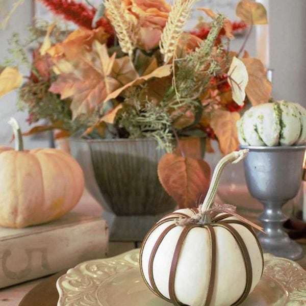 These simple DIY leather wrapped pumpkins are perfect for your holiday table or for any part of your fall decor! Find out all about it at http//:Ablissfulnest.com/ #Fall #pumpkins #FallDIY