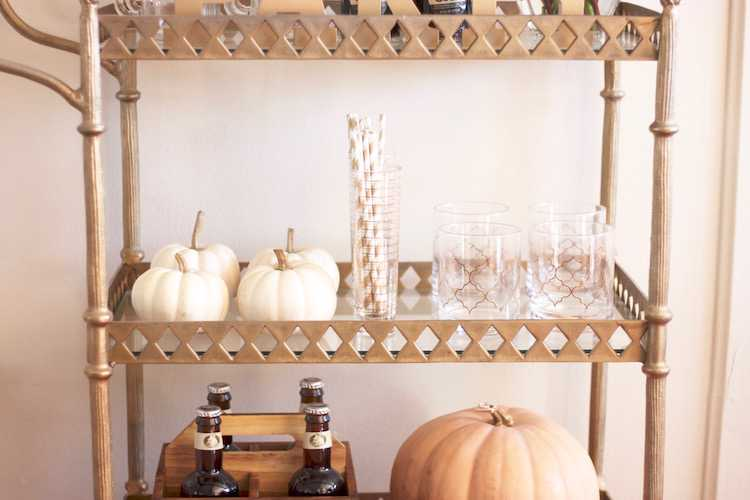 This festive fall bar cart is perfect for any entertaining occasion or even a quiet evening at home. Be prepared for anyone who may stop by, too! Seen on https://ablissfulnest.com/ #fall #entertaining #barcart