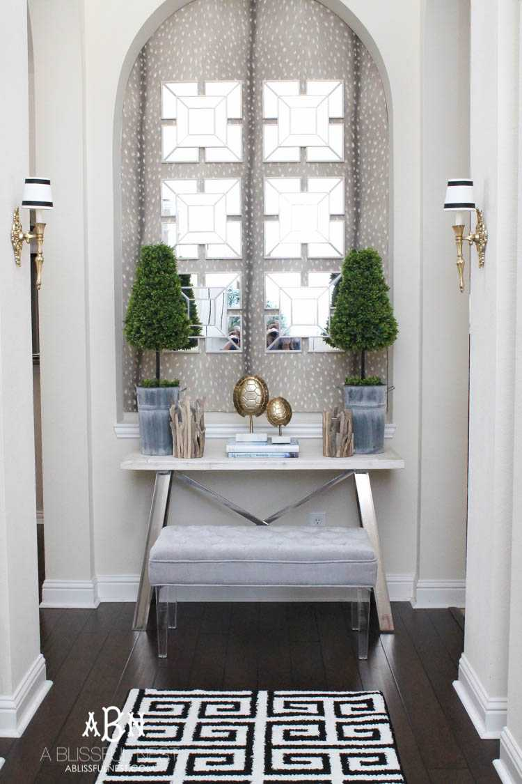 Entryway Decor: Get these tips & hints on getting designer style on a budget with this gorgeous entry makeover! So many great ideas here! See more on https://ablissfulnest.com/ #entrymakeover #designtips