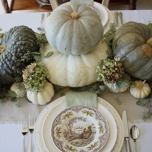 This neutral Fall tablescape is full of natural elements, brown toile dishes and loads of pumpkins and dried florals. Visit http://ablissfulnest.com/ for all of the details! #NeutralDecor #Fall #FallTablescape