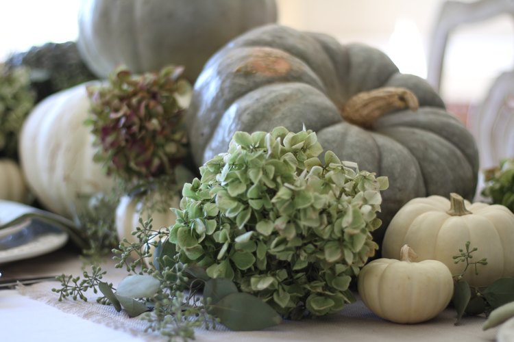 This neutral Fall tablescape is full of natural elements, brown toile dishes and loads of pumpkins and dried florals. Visit https://ablissfulnest.com/ for all of the details! #NeutralDecor #Fall #FallTablescape